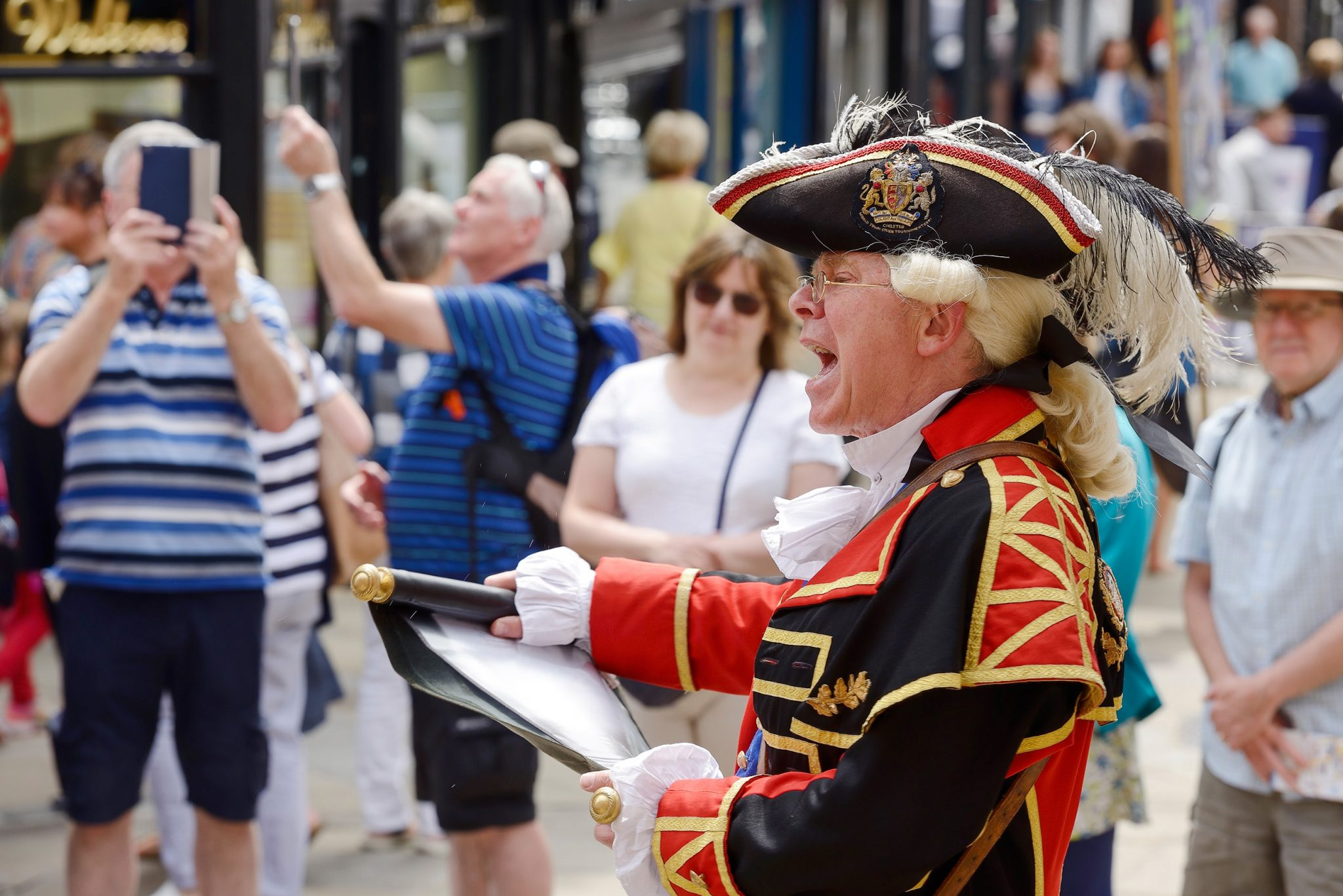 The Town Crier making middday proclamations at The Cross, Chester, UK